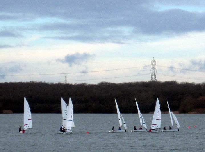 Photo of dinghies sailing for Cambridge sailing support funds