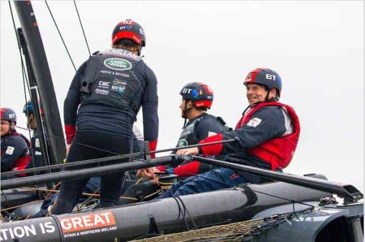 Photo og Dave Wilkins steering an America;s Cup foiling cararaman